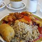 Sweet and sour chicken, fried rice, and egg roll