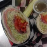 WRAP IT UP...TRY OUR WRAP'S...USING ALL BOAR'S HEAD MEATS!,and CHEESES.