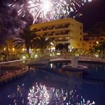 Firework celebrations seen from poolside