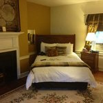 Queen size bed with working fireplace