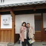 My mom and me in front of the Guesthouse