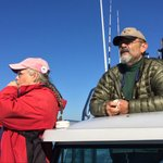 Jeanne and Captain Jim scanning the water for whales.