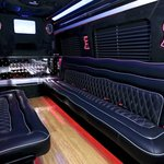 Custom made private seating for up to 14 rear passengers twice the space of a normal Limo