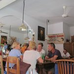 Restaurant frequented by locals who can afford and tourists alike