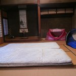 Futons on tatami floors (we brought our own tents for the little kids)