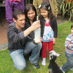 Our Japanese Guests Helping to feed our adopted lamb