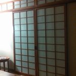 Japanese-style sliding doors to bedroom.