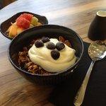 Toasted organic granola w greek yoghurt & fruit salad