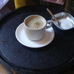 A coffee served in an uncleaned tray