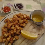 Corn fish (cod fillet) served with drawn butter, real home-fries, homemade partridgeberry and ba