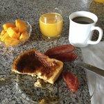 Delicious french toast, chorizo, papaya, orange juice & Luis' homemade coffee bean brew!