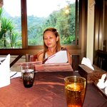 Studying the menu n the restaurant -- notice the view