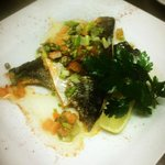 Grilled Fillet of Sea Bass on a bed of Scallion mash, served with sauce verge