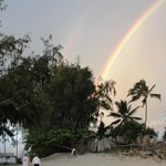 sunrise at beach - double rainbow