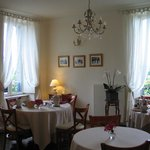 Simple elegance; dining room with tables dressed for breakfast