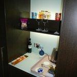 backllit modern mini bar in room