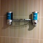 Bliss products in dispenser in shower.