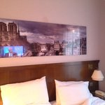 bed and panorama photo of Paris