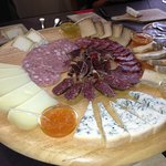 Sampling of cheese and ham to be tasted with different types of mustards