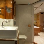 En-suite bathroom with toilet, shower, hairdryer, make-up mirror and thick towels