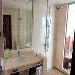 Shower only. Glass divider between bath and bedroom. Popular in China. Get used to it.