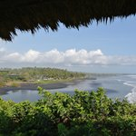 The resort and the black sand beach