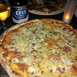 A hugh pizza and a beer