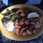 Fried shrimp with green beans and garlic smash potatoes.