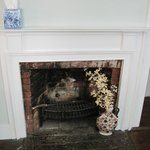 The charming fireplace in the Forbush Room