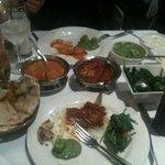 lamb vindaloo, fish curry, rice, naans, cottage cheese, jaita
