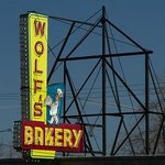 Wolf's large  sidewalk overhanging 50's style neon sign.