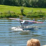 Bushplane landing demonstration on the Chena River along side the boat