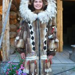 An Athabascan teen modeling a traditional winter coat