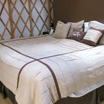 King size bed, luxurious linens in Yurt