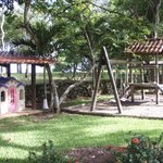 Swingset and play area overlooking beach and pool