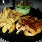 Grilled chicken with barbecue sauce, fresh salad and potatoes