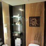 Marble wall and terracotta tile in bathroom