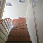 Stairs down to front door/bathroom