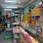 Pastry shops. Specialties are almond cookies and egg tarts.