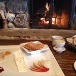 Cheese plate on the couch by the fire