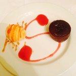 Chocolate gateaux and orange ice cream