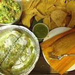 (via delivery) guacamole, tacos dorados, and a pork tamal