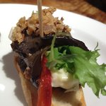 Roasted eggplant with red pepper, cheese and crispy shallots