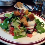 Mixed Greens Salad with tomato, sun dried cranberries, dates, pine nuts & champagne vinaigrette.
