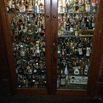 a collection cabinet in the bar