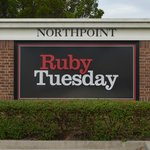 Street sign for Ruby Tuesday on Pine Island Rd.