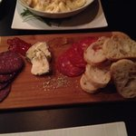 Small cheese platter; elk sausage, salami & soft Brie cheese