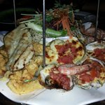 Seafood platter: Baked oysters, fish fillet and calamari