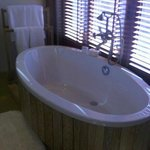 Bath with windows opening to outside