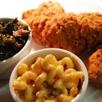 """Westchester's Best"" Fried Chicken, served with braised greens and mac & cheese."